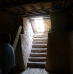 Stairs down into dark stone cellar