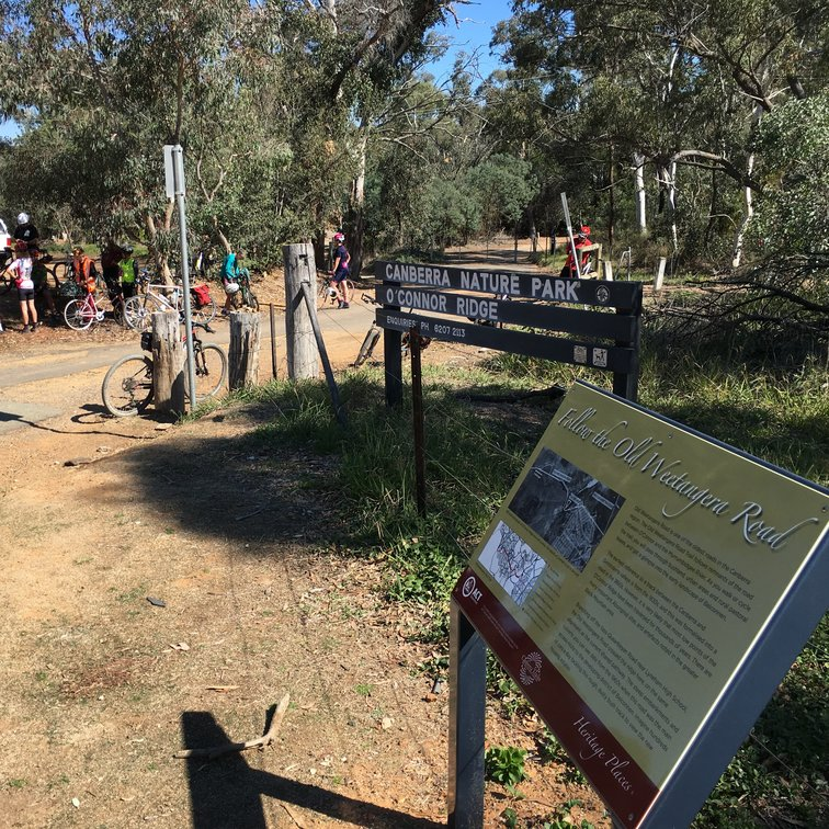 Old Weetangera Road interpretive sign with entrance to Canberra Nature Park in background