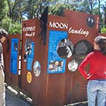 Woman looking at interpretive signage about the moon landing